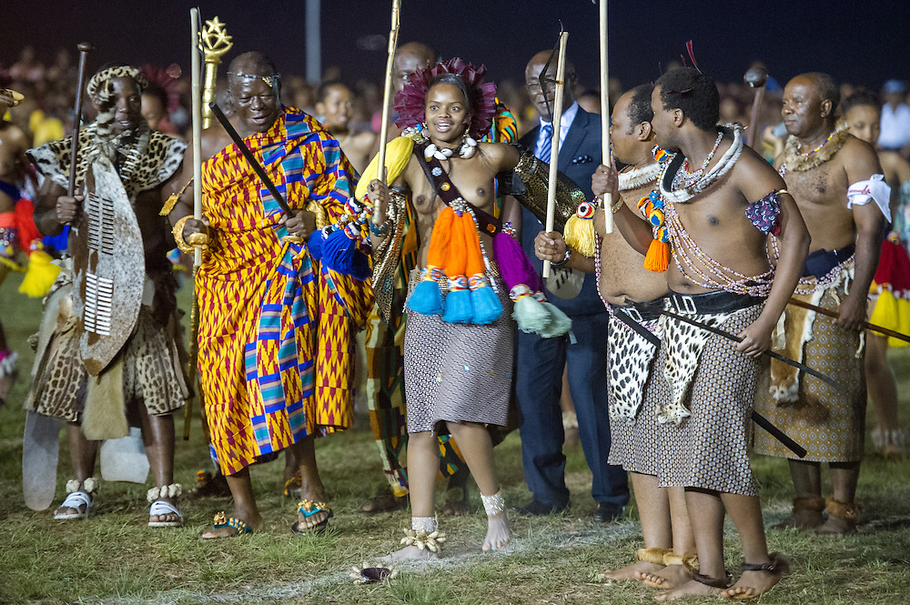 Ludzidzini, Swaziland, Africa - Annual Umhlanga, or reed dance ceremony, in which up to 100,000 young Swazi women gather to celebrate their virginity and honor the queen mother during the 8 day long event.<br /> Princess dancing with princes and visiting kings