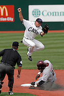 Kansas State shortstop Eli Rumler (top) goes up high to catch a high throw, as Oklahoma's Joe Dunigan (21) slides into second base with a stolen base in the top of the fourth inning at Tointon Stadium in  Manhattan, Kansas, April 22, 2007.  Oklahoma defeated Kansas State 12-4.