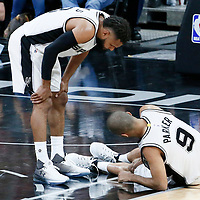 03 May 2017: San Antonio Spurs guard Patty Mills (8) looks at San Antonio Spurs guard Tony Parker (9) laying down on the floor with a knee injury during the San Antonio Spurs 121-96 victory over the Houston Rockets, in game 2 of the Western Conference Semi Finals, at the AT&T Center, San Antonio, Texas, USA.