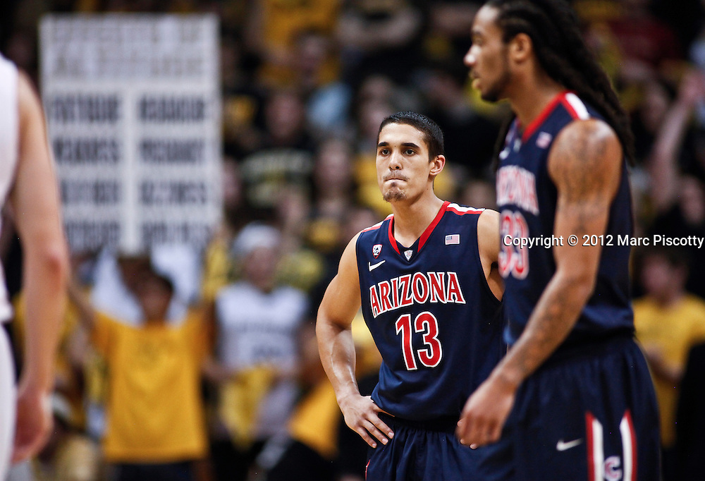 SHOT 1/21/12 5:34:19 PM - Arizona's Nick Johnson #13 reacts to his team being down while playing against Colorado during their PAC 12 regular season men's basketball game at the Coors Events Center in Boulder, Co. Colorado won the game 64-63..(Photo by Marc Piscotty / © 2012)