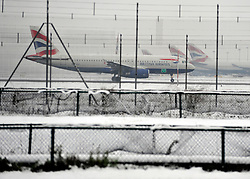 © Licensed to London News Pictures. 05/02/2012, London, UK. A plane taxis for take off on a runway. Planes in the snow at Heathrow Airport today 05/02/12. The airport has cancelled a third of its flights because of the snow. Heavy snow has fallen over many parts of the UK overnight. Photo credit : Stephen Simpson/LNP