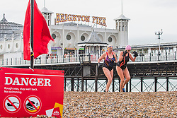 © Licensed to London News Pictures. 06/01/2018. Brighton, UK. Members of the Brighton Swimming Club return from their daily swim in the Brighton and Hove sea as temperatures have dropped to 5C. Photo credit: Hugo Michiels/LNP