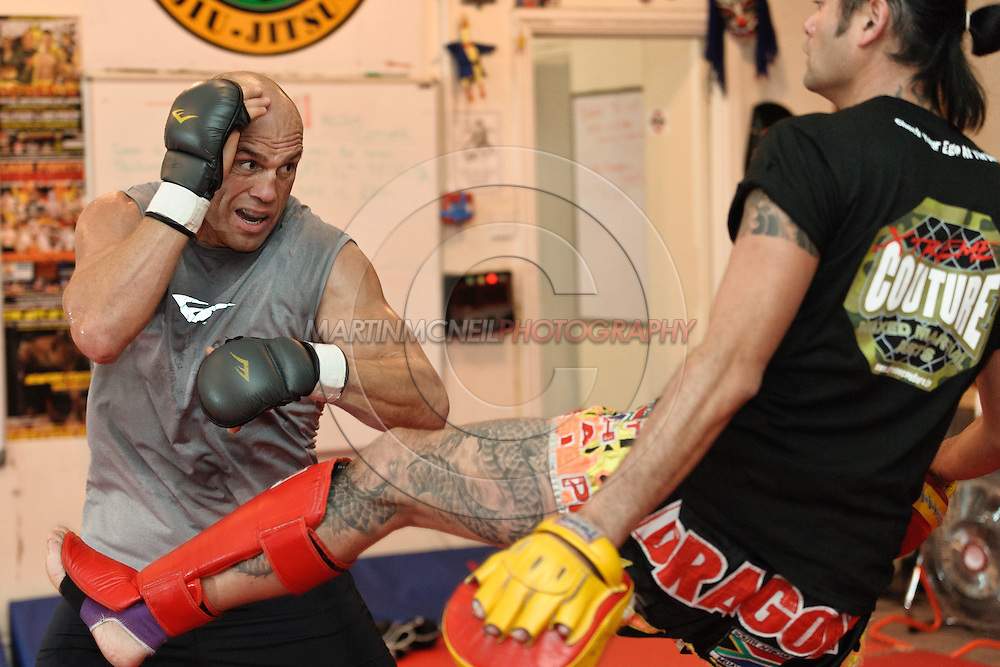 Randy Couture (left) and Quentin Chong work on muay thai stiking defence during a pre-fight training session at Straight Blast Gym ahead of UFC 105 in Manchester, England on November 12, 2009.