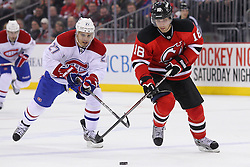 Feb 2; Newark, NJ, USA; New Jersey Devils right wing Steve Bernier (18) skates with the puck while being defended by Montreal Canadiens left wing Rene Bourque (27) during the second period at the Prudential Center.