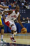 Team USA forward Tamika Catchings drives to the basket during the 2012 USA Women's Basketball Team versus Brazil at Verizon Center in Washington, DC.  USA won 99-67.  July 16, 2012  (Photo by Mark W. Sutton)