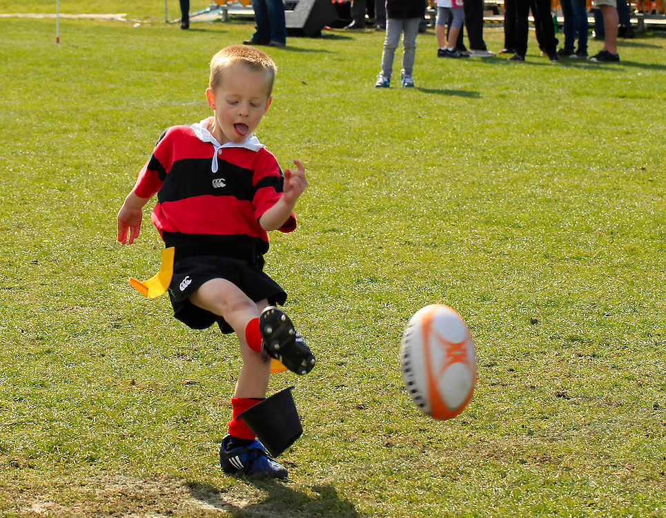 5 year old Caden Lewis from the Mighty Christchurch under 6 red rugby team kicking a ball while waiting for the Scottish World Cup Rugby team during their visit to Christchurch, Fanzone, North Hagley Park, Christchurch, New Zealand, Saturday, September 17, 2011.  Credit:SNPA / Pam Johnson