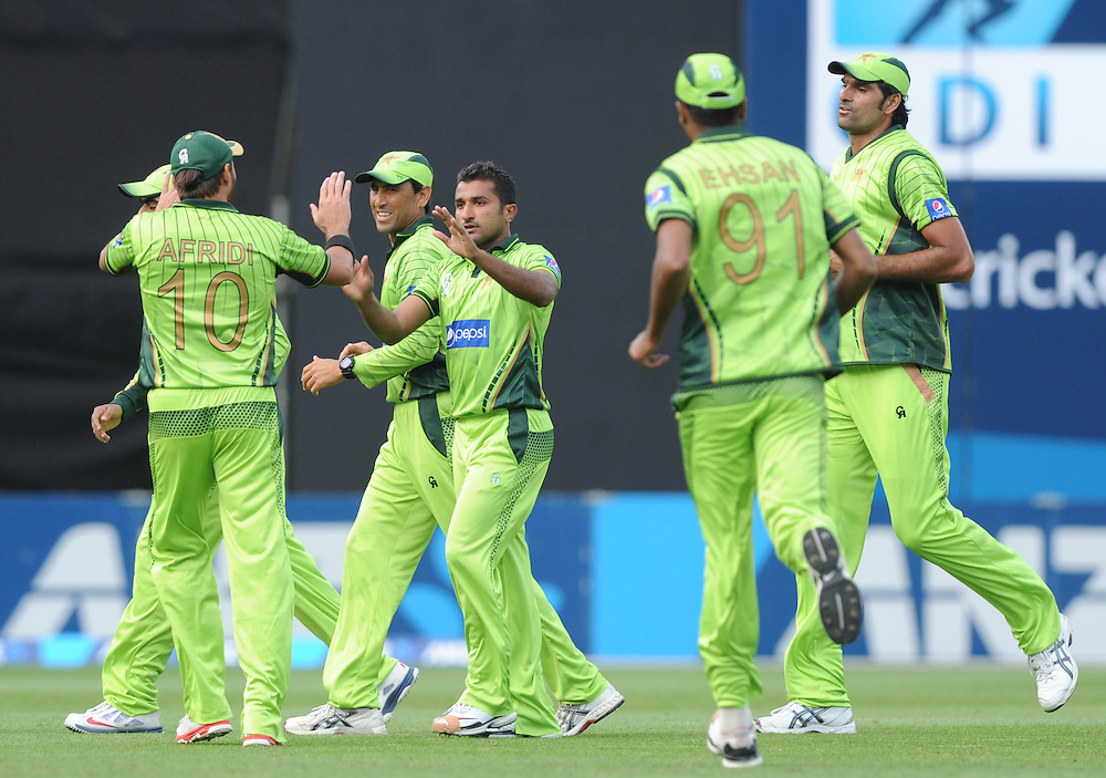 Pakistan's Bilawal Bhatti, centre, after taking the wicket of New Zealand's Brendon McCullum for 17 in the 1st One Day International cricket match at Westpac Stadium, New Zealand, Saturday, January 31, 2015. Credit:SNPA / Ross Setford