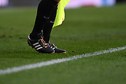 The assistant referee's shoe laces in support of Stonewall's Rainbow Laces campaign during the EFL Sky Bet Championship match between Leeds United and Bristol City at Elland Road, Leeds, England on 24 November 2018.