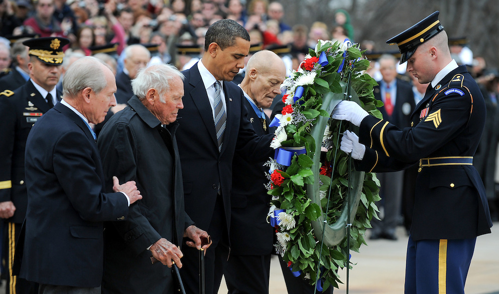 U.S. President Barack Obama (3L) walks with a group of Medal of Honor recipients as they lay a wreath at the Tomb of The Unknown Soldier in Arlington National Cemetery in Arlington, Virginia, USA to mark National Medal of Honor Day on 25 March 2009. The annual event is dedicated to recipients of the Congressional Medal of Honor, the highest honor the United States can bestow on a member of the US Armed Forces.