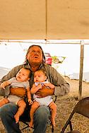 Henry Real Bird, Crow Elder, twin grandchildren, Crow Fair, Montana