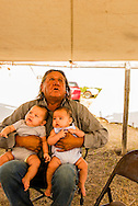 Henry Real Bird, Crow Elder, twin grandchildren, Crow Fair, Montana