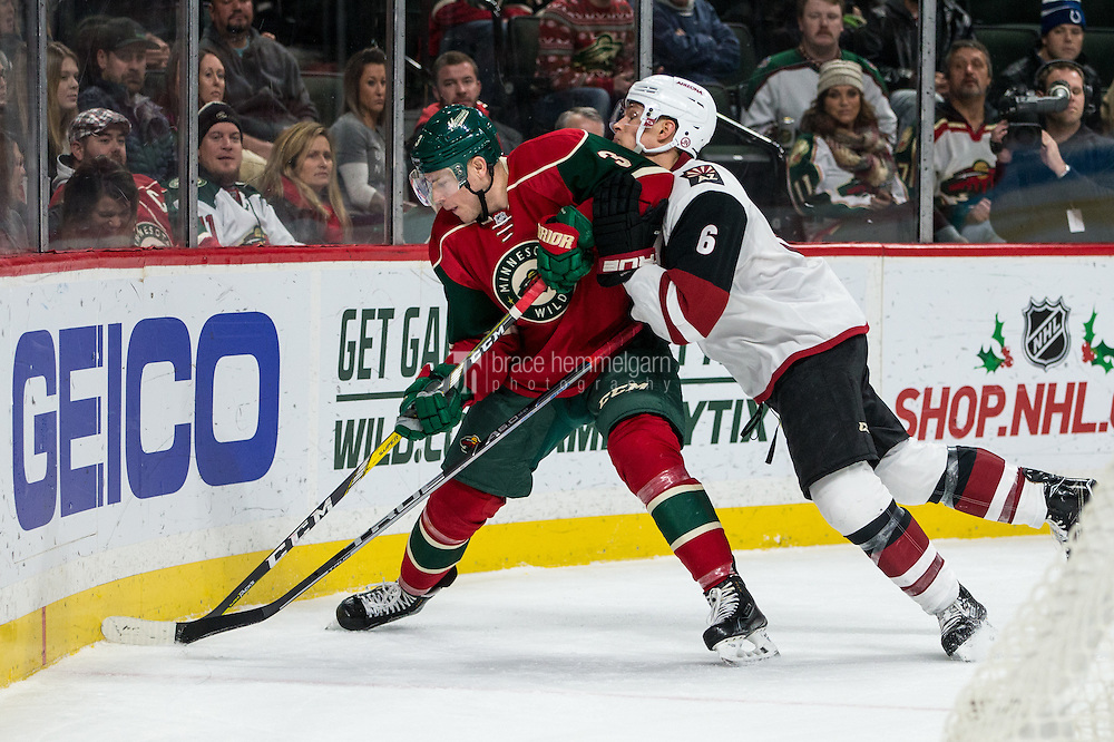 Dec 17, 2016; Saint Paul, MN, USA; Arizona Coyotes defenseman Jakob Chychrun (6) hits Minnesota Wild forward Charlie Coyle (3) during the second period at Xcel Energy Center. Mandatory Credit: Brace Hemmelgarn-USA TODAY Sports
