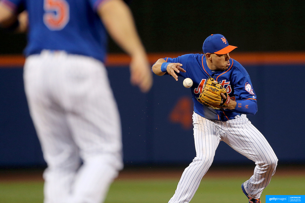 NEW YORK, NEW YORK - May 19: Asdrubal Cabrera #13 of the New York Mets loses the ball as he attempts an out in the third inning during the Washington Nationals Vs New York Mets regular season MLB game at Citi Field on May 19 2016 in New York City. (Photo by Tim Clayton/Corbis via Getty Images)