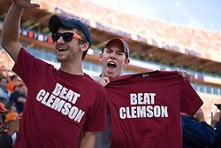"November 21, 2009; Clemson, SC, USA;  Virginia Cavaliers fans hold up ""Beat Clemson"" t-shirts during the first quarter against the Clemson Tigers at Memorial Stadium.  Clemson defeated Virginia 34-21."