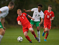 WREXHAM, WALES - Wednesday, October 30, 2019: Wales' Aaron Bennett (L) and Republic of Ireland's Glory Nzingo during the 2019 Victory Shield match between Wales and Republic of Ireland at Colliers Park. (Pic by David Rawcliffe/Propaganda)