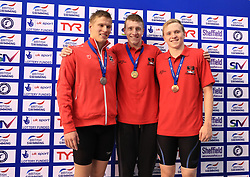 The medal ceremony for the men's 400m Individual Medly final, gold medalist Max Litchfield (centre) silver medalist Mark Szaranek (left) and bronze medalist Joe Litchfield during day three of the 2017 British Swimming Championships at Ponds Forge, Sheffield.