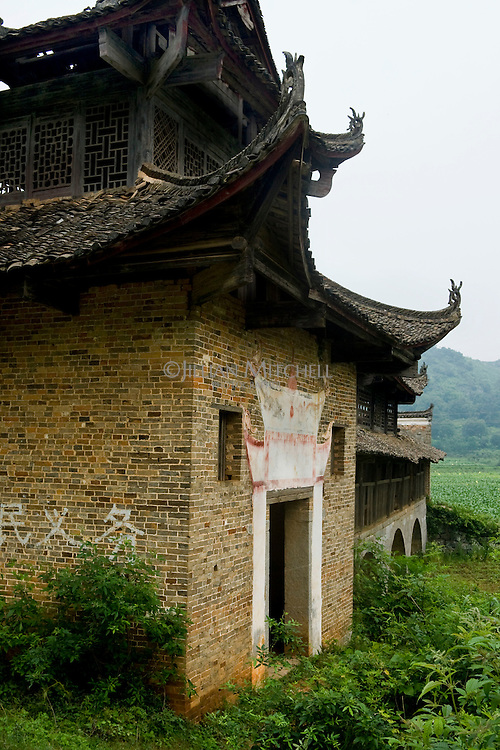 Old wind and rain bridge located in the fields of the Fuchuan Yao autonomous region in Guangxi, China.
