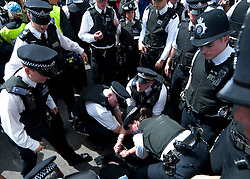 licensed to London News Pictures. London, UK. 30th June 2011. Clashes ensue between police and protesters on Whitehall as anti-austerity protests take place. . Please see special instructions for usage rates. Photo credit should read Jules Mattsson/LNP