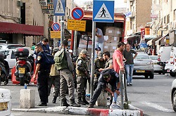 18.10.2015, Jerusalem, ISR, Gewalt zwischen Palästinensern und Israelis, im Bild Zusammenstösse zwischen Palästinensischen Demonstranten und Israelischen Sicherheitskräfte // Israeli border policemen search a Palestinian man in Jerusalem's Old city on October 18, 2015. Forty-one Palestinians and seven Israelis have died in recent street violence, which was in part triggered by Palestinians' anger over what they see as increased Jewish encroachment on Jerusalem's al-Aqsa mosque compound, Israel on 2015/10/18. EXPA Pictures © 2015, PhotoCredit: EXPA/ APAimages/ Mahfouz Abu Turk<br /> <br /> *****ATTENTION - for AUT, GER, SUI, ITA, POL, CRO, SRB only*****