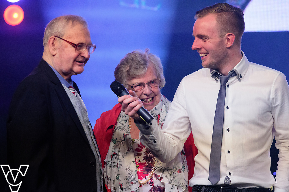 George and Doreen Ashton onstage after receiving their Lifetime Achievement Award, being interviewed by Rob Makepeace<br /> <br /> Lincoln City Football Club's 2016/17 End of Season Awards night - Champions Seasons Awards Dinner - held at the Lincolnshire Showground.<br /> <br /> Picture: Andrew Vaughan for Lincoln City Football Club<br /> Date: May 20, 2017 Champions Seasons Awards Dinner: