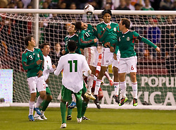 February 24, 2010; San Francisco, CA, USA;  Bolivia midfielder Samuel Galindo (11) sends a free kick over the wall of Mexico forward Javier Hernandez (11) and defender Hugo Ayala (4) and midfielder Gerardo Torrado (6) during the first half at Candlestick Park. Mexico defeated Bolivia 5-0.