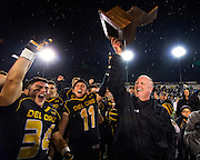 Del Oro Golden Eagle's, head coach Casey Taylor holds up the state championship trophy after their 16-13 victory over Camarillo Scorpions to win the CIF State Division II-AA championship football game played at Sacramento State, Friday Dec 18, 2015.<br /> Brian Baer/Special to the Bee