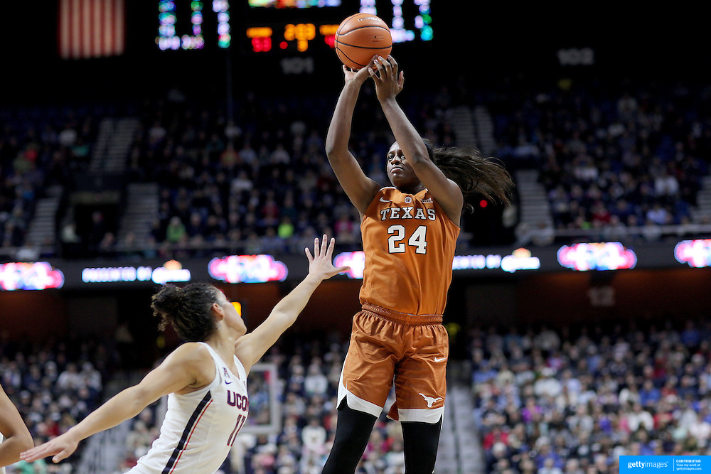 UNCASVILLE, CONNECTICUT- DECEMBER 4:  Joyner Holmes #24 of the Texas Longhorns shoots while defended by Kia Nurse #11 of the Connecticut Huskies during the UConn Huskies Vs Texas Longhorns, NCAA Women's Basketball game in the Jimmy V Classic on December 4th, 2016 at the Mohegan Sun Arena, Uncasville, Connecticut. (Photo by Tim Clayton/Corbis via Getty Images)