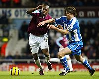 Photo: Chris Ratcliffe.<br />West Ham United v Wigan Athletic. The Barclays Premiership. 28/12/2005.<br />Marlon Harewood (L) of West Ham beats Arjen de Zeeuw to the ball.