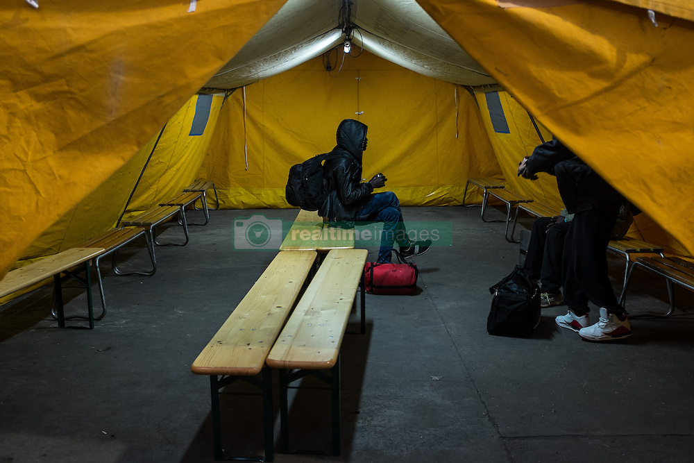 October 25, 2016 - Calais, France - Migrants are waiting for the departure of the bus which takes them to their new accommodation at the registration center in the jungle of Calais  in Calais, France, on 25 October 2016. Up to the evening, about 4,000 migrants from the Refugee camp on the coast at the English Channel were distributed to several regions in France. The police have begun to tear down the huts and tents in the camp. (Credit Image: © Markus Heine/NurPhoto via ZUMA Press)