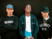 Three teenage boys wearing caps and crosses round their necks