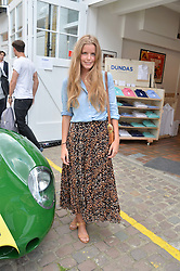 KATIE READMAN at the launch of Dundas London held at Fiskins Classic Car Showroom, 14 Queens Gate Place Mews, London on 25th June 2014.