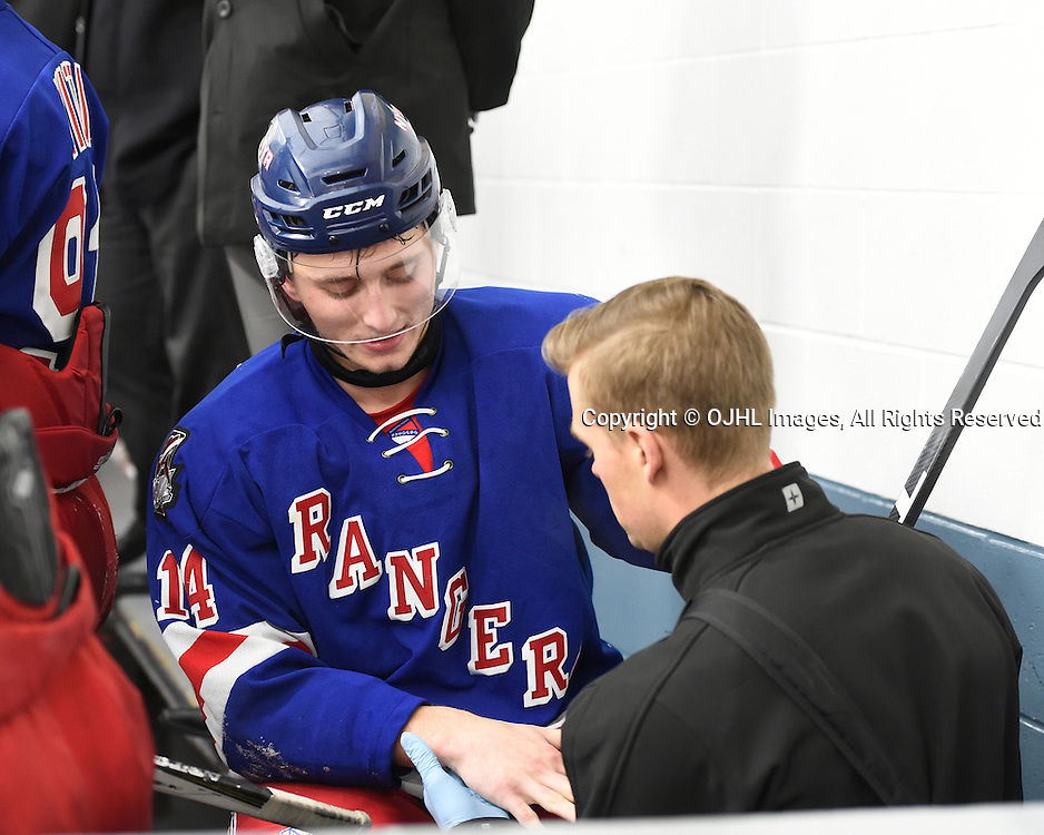 TRENTON, ON - JAN 25,  2017: Ontario Junior Hockey League game between North York and Buffalo at the 2017 Winter Showcase , Ethan Wiseman #14 of the North York Rangers gets attended to by the team trainer during the first period.<br /> (Photo by Andy Corneau / OJHL Images)