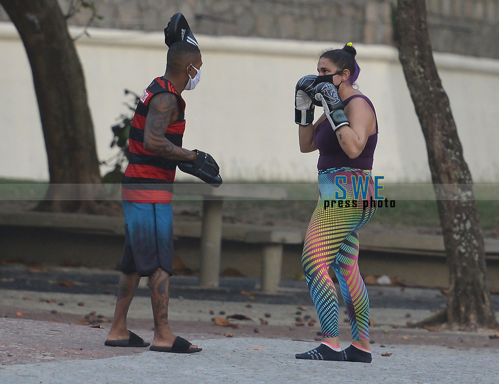 Rio de Janeiro-Brazil May 2, 2020, Population trains boxing and plays football, during the Coronavirus pandemic in Copacabana