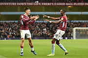 Aston Villa striker(on loan from Chelsea) Tammy Abraham (18) scores a goal and celebrates  4-4 with Aston Villa midfielder Jack Grealish (10) during the EFL Sky Bet Championship match between Aston Villa and Nottingham Forest at Villa Park, Birmingham, England on 28 November 2018.