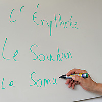HG centre de formation, Rue de Lyon.<br /> <br /> French language class for asylum seekers, with a  teacher on reinsertion.