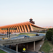 The late afternoon sunlight catches the original building, shaped like a wing, of Dulles International Airport in Chantilly, Virginia. Opened in 1962, Dulles Airport is one of three large airports serving the Washington DC region.