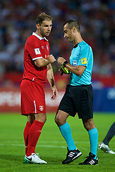 BELGRADE, SERBIA - Sunday, June 11, 2017: Serbia's captain Branislav Ivanovic speaks to the referee Manuel De Sousa during the 2018 FIFA World Cup Qualifying Group D match between Wales and Serbia at the Red Star Stadium. (Pic by David Rawcliffe/Propaganda)