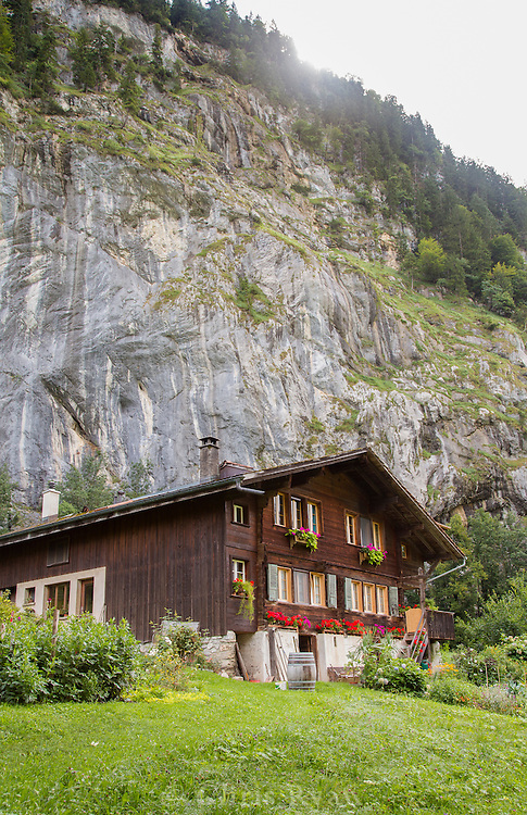 Chalet beneath cliffs in Lauterbrunnen Valley, Switzerland