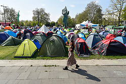 "© Licensed to London News Pictures. 22/04/2019. LONDON, UK. Activists' tents at Marble Arch during ""London: International Rebellion"", on day eight of a protest organised by Extinction Rebellion.  Protesters are demanding that governments take action against climate change.  After police issued section 14 orders at the other protest sites of Oxford Circus, Waterloo Bridge and Parliament Square resulting in over 900 arrests, protesters have convened at the designated site of Marble Arch so that the protest can continue.  Photo credit: Stephen Chung/LNP"