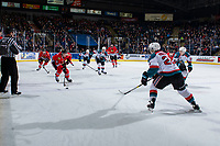 KELOWNA, CANADA - MARCH 2:  Schael Higson #21 of the Kelowna Rockets back checks as Robbie Fromm-Delorme #11 of the Portland Winterhawks skates up the ice with the puck during first period on March 2, 2019 at Prospera Place in Kelowna, British Columbia, Canada.  (Photo by Marissa Baecker/Shoot the Breeze)