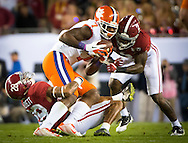 #7 Mike Williams of Clemson is tackled by #28 Anthony Averett and #2 Tony Brown of Alabama.