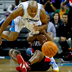 January 16, 2012; New Orleans, LA, USA; New Orleans Hornets point guard Jarrett Jack (2) is grabbed by Portland Trail Blazers point guard Raymond Felton (5) as he scrambles for a loose ball during the second quarter of a game at the New Orleans Arena.   Mandatory Credit: Derick E. Hingle-USA TODAY SPORTS