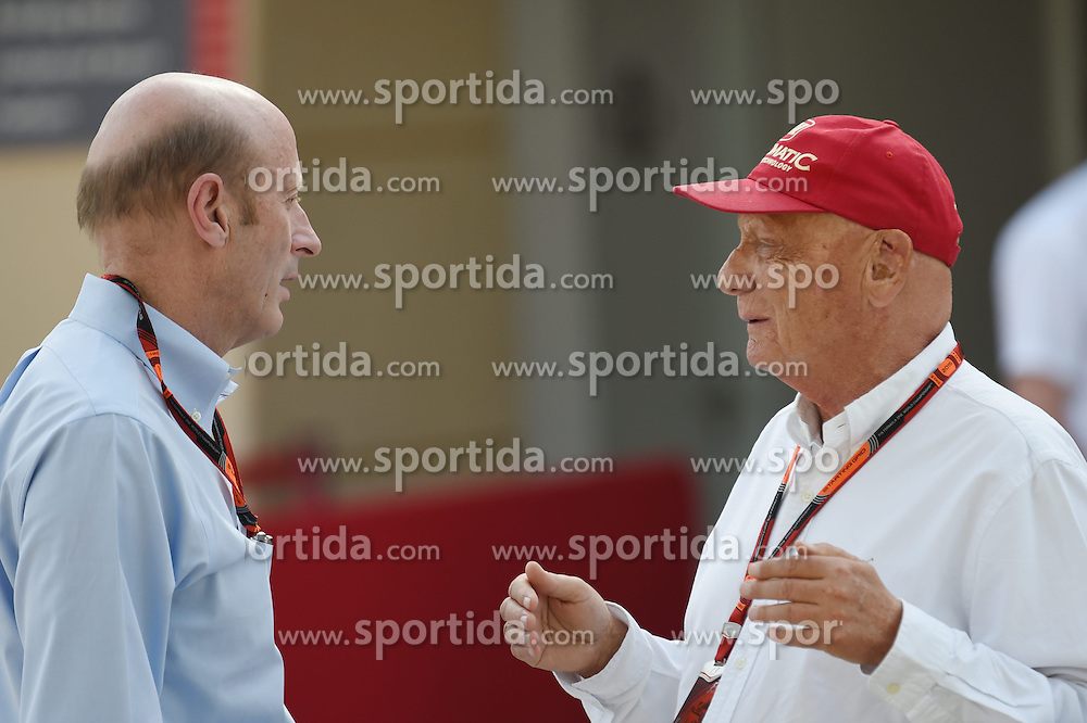 18.04.2015, International Circuit, Sakhir, BHR, FIA, Formel 1, Grand Prix von Bahrain, Qualifying, im Bild Donald Mackenzie (GBR) CVC CAPITALPartners Managing Partner - Co Head of Global Investments and Niki Lauda (AUT) Mercedes AMG F1 Non-Executive Chairman // during Qualifying of the FIA Formula One Bahrain Grand Prix at the International Circuit in Sakhir, Bahrain on 2015/04/18. EXPA Pictures &copy; 2015, PhotoCredit: EXPA/ Sutton Images/ Mark<br /> <br /> *****ATTENTION - for AUT, SLO, CRO, SRB, BIH, MAZ only*****
