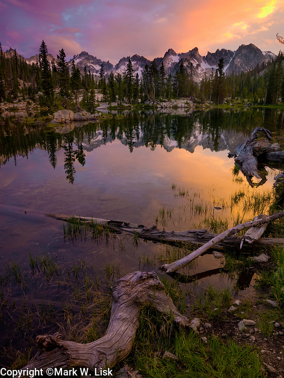 A brilliant sunset reflects from the rugged peaks above Alice Lake high in the Sawtooth Wilderness of central Idaho.