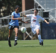 Ole Miss' Abbie Curran (14) vs. The Citadel's Jaslene Thiara (12) in women's soccer action at the Ole Miss Soccer Field in Oxford, Miss. on Monday, September 12, 2011. Ole Miss won 6-1.