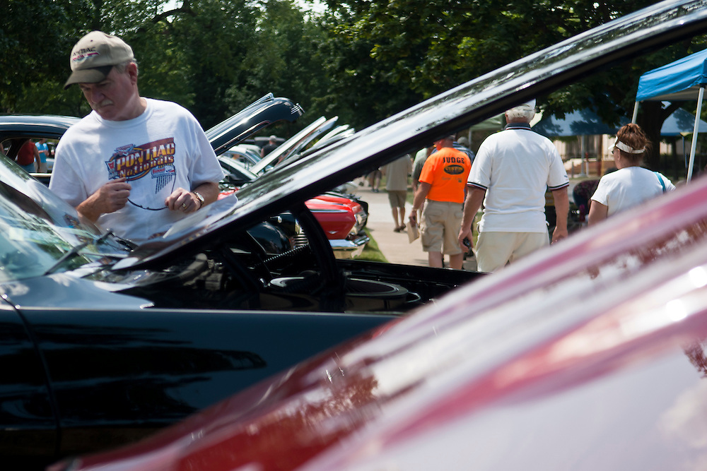 Lathan Goumas | MLive.com..Robert Orr, of Bay CIty, looks at a 1971 Pontiac GT-37 during the 40th Sloan Museum Auto Fair at the Flint Cultural Center in Flint, Mich. on Saturday, June 23, 2012.