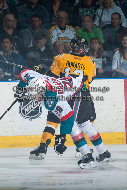 KELOWNA, CANADA - MAY 13: Rihards Bukarts #13 of Brandon Wheat Kings checks Leon Draisaitl #29 of Kelowna Rockets on May 13, 2015 during game 4 of the WHL final series at Prospera Place in Kelowna, British Columbia, Canada.  (Photo by Marissa Baecker/Shoot the Breeze)  *** Local Caption *** Rihards Bukarts; Leon Draisaitl;