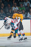 KELOWNA, CANADA - MAY 13: Rihards Bukarts #13 of Brandon Wheat Kings checks Leon Draisaitl #29 of Kelowna Rockets on May 13, 2015 during game 4 of the WHL final series at Prospera Place in Kelowna, British Columbia, Canada.  (Photo by Marissa Baecker/Shoot the Breeze)  *** Local Caption *** Rihards Bukarts; Leon Draisaitl;
