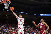 FAYETTEVILLE, AR - MARCH 9:  Daniel Gafford #10 of the Arkansas Razorbacks goes up for a lay up past Galin Smith #30 of the Alabama Crimson Tide at Bud Walton Arena on March 9, 2019 in Fayetteville, Arkansas.  The Razorbacks defeated the Crimson Tide 82-70.  (Photo by Wesley Hitt/Getty Images) *** Local Caption *** Daniel Gafford; Galin Smith