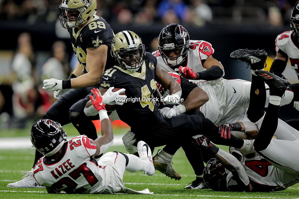 Nov 22, 2018; New Orleans, LA, USA; New Orleans Saints running back Alvin Kamara (41) is tackled by Atlanta Falcons linebacker Duke Riley (42) and safety Damontae Kazee (27) during the third quarter at the Mercedes-Benz Superdome. Mandatory Credit: Derick E. Hingle-USA TODAY Sports